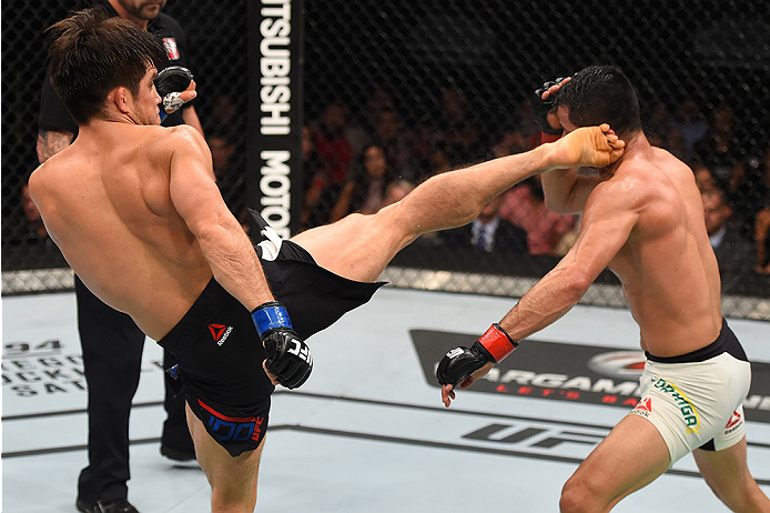 MONTERREY, MEXICO - NOVEMBER 21:  (L-R) Henry Cejudo of the United States kicks Jussier Formiga of Brazil in their flyweight bout during the UFC Fight Night event at Arena Monterrey on November 21, 2015 in Monterrey, Mexico.  (Photo by Jeff Bottari/Zuffa LLC/Zuffa LLC via Getty Images)