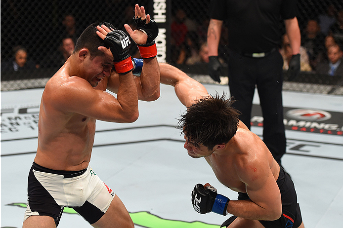 MONTERREY, MEXICO - NOVEMBER 21: (R-L) Henry Cejudo of the United States punches Jussier Formiga of Brazil in their flyweight bout during the UFC Fight Night event at Arena Monterrey on November 21, 2015 in Monterrey, Mexico.  (Photo by Jeff Bottari/Zuffa LLC/Zuffa LLC via Getty Images)