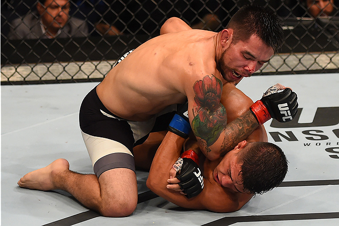 (L-R) Ray Borg lands an elbow against Geane Herrera in their flyweight bout during the UFC Fight Night event at Bridgestone Arena on August 8, 2015 in Nashville, Tennessee. (Photo by Josh Hedges/Zuffa LLC)