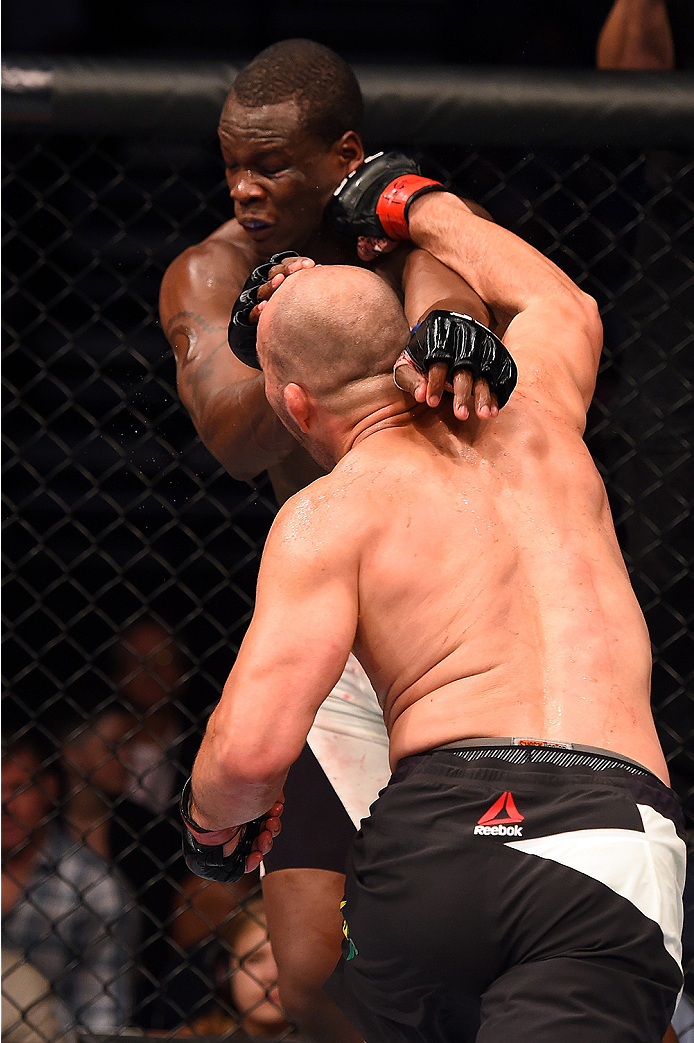 Glover Teixeira of Brazil punches Ovince Saint Preux in their light heavyweight bout during the UFC Fight Night event at Bridgestone Arena on August 8, 2015 in Nashville, Tennessee. (Photo by Josh Hedges/Zuffa LLC)