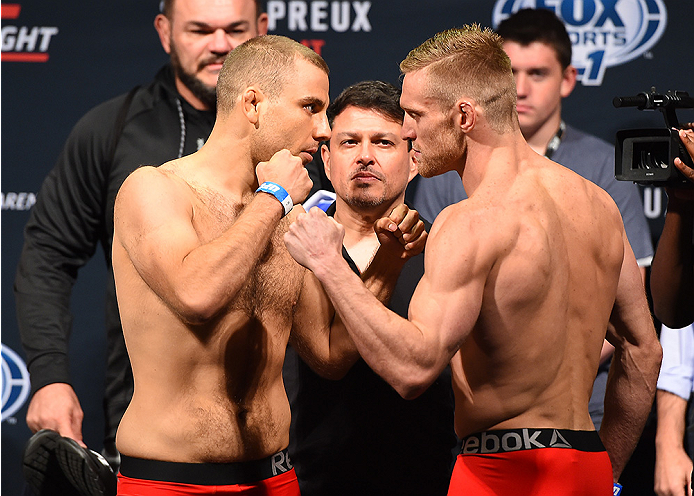 NASHVILLE, TN - AUGUST 07:  (L-R) Opponents Anthony Christodoulou of Greece and Scott Holtzman face off during the UFC weigh-in at Bridgestone Arena on August 7, 2015 in Nashville, Tennessee.  (Photo by Josh Hedges/Zuffa LLC/Zuffa LLC via Getty Images)