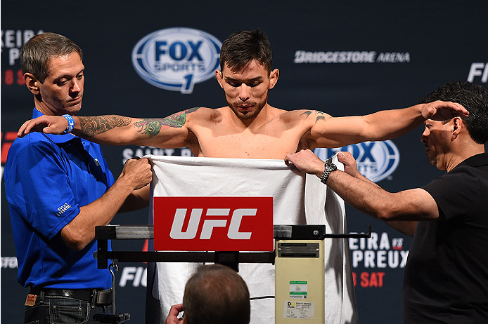NASHVILLE, TN - AUGUST 07:  Ray Borg steps on the scale during the UFC weigh-in at Bridgestone Arena on August 7, 2015 in Nashville, Tennessee.  (Photo by Josh Hedges/Zuffa LLC/Zuffa LLC via Getty Images)