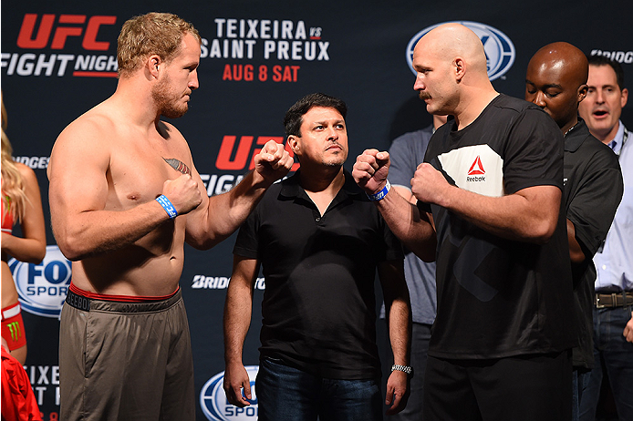 NASHVILLE, TN - AUGUST 07:  (L-R) Opponents Jared Rosholt and Timothy Johnson face off during the UFC weigh-in at Bridgestone Arena on August 7, 2015 in Nashville, Tennessee.  (Photo by Josh Hedges/Zuffa LLC/Zuffa LLC via Getty Images)