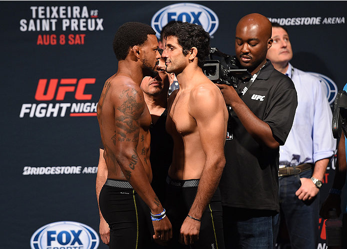 NASHVILLE, TN - AUGUST 07:  (L-R) Opponents Michael Johnson and Beneil Dariush of Iran face off during the UFC weigh-in at Bridgestone Arena on August 7, 2015 in Nashville, Tennessee.  (Photo by Josh Hedges/Zuffa LLC/Zuffa LLC via Getty Images)