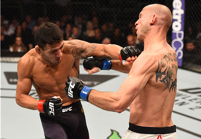 (L-R) Rafael dos Anjos punches Donald Cerrone in their UFC lightweight title bout during the UFC Fight Night event. (Josh Hedges)