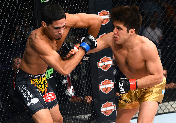 Cejudo throws a punch vs. Dustin Kimura