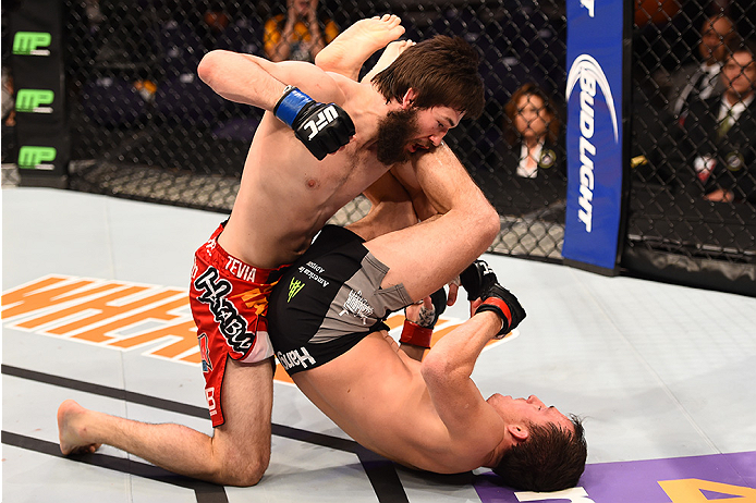 PHOENIX, AZ - DECEMBER 13:  (L-R) Bryan Barberena punches Joe Ellenberger  in their lightweight fight during the UFC Fight Night event at the U.S. Airways Center on December 13, 2014 in Phoenix, Arizona.  (Photo by Josh Hedges/Zuffa LLC/Zuffa LLC via Getty Images)
