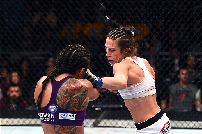 <a href='../fighter/Joanna-Jedrzejczyk'>Joanna Jedrzejczyk</a> punches <a href='../fighter/Claudia-Gadelha'>Claudia Gadelha</a> during their first meeting at Fight Night Phoenix