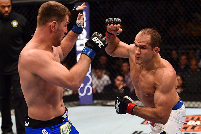 Dos Santos punches Stipe Miocic during their first meeting in December of 2014
