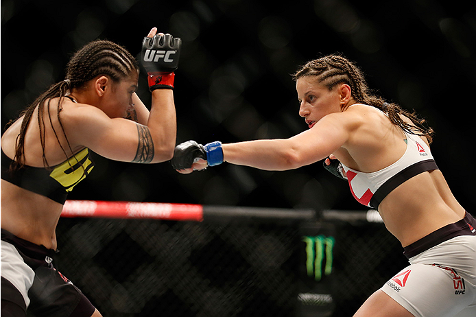 SAN DIEGO, CA - JULY 15:   (R-L) Sarah Moras of Canada punches Jessica Andrade of Brazil in their women's bantamweight bout during the UFC event at the Valley View Casino Center on July 15, 2015 in San Diego, California. (Photo by Todd Warshaw/Zuffa LLC/Zuffa LLC via Getty Images)