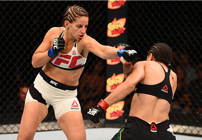 SAN DIEGO, CA - JULY 15:   (L-R) Sarah Moras of Canada punches Jessica Andrade of Brazil in their women's bantamweight bout during the UFC event at the Valley View Casino Center on July 15, 2015 in San Diego, California. (Photo by Jeff Bottari/Zuffa LLC/Zuffa LLC via Getty Images)