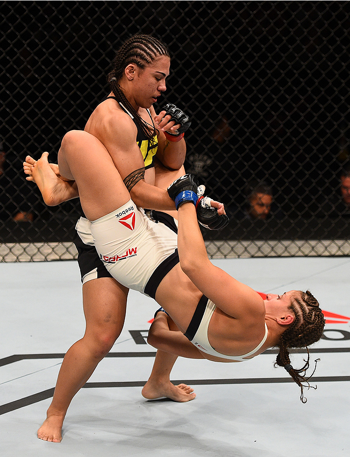 SAN DIEGO, CA - JULY 15:   (R-L) Sarah Moras of Canada attempts to submit Jessica Andrade of Brazil in their women's bantamweight bout during the UFC event at the Valley View Casino Center on July 15, 2015 in San Diego, California. (Photo by Jeff Bottari/Zuffa LLC/Zuffa LLC via Getty Images)