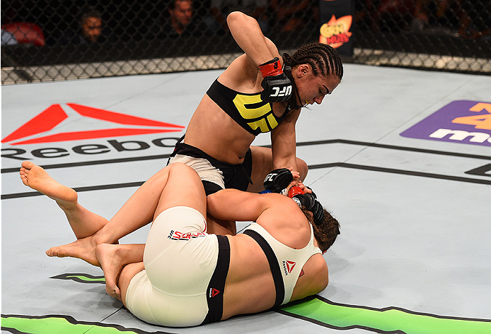 SAN DIEGO, CA - JULY 15:   Jessica Andrade (top) of Brazil punches Sarah Moras of Canada in their women's bantamweight bout during the UFC event at the Valley View Casino Center on July 15, 2015 in San Diego, California. (Photo by Jeff Bottari/Zuffa LLC/Zuffa LLC via Getty Images)