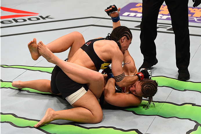 SAN DIEGO, CA - JULY 15:   Jessica Andrade (top) of Brazil elbows Sarah Moras of Canada in their women's bantamweight bout during the UFC event at the Valley View Casino Center on July 15, 2015 in San Diego, California. (Photo by Jeff Bottari/Zuffa LLC/Zuffa LLC via Getty Images)