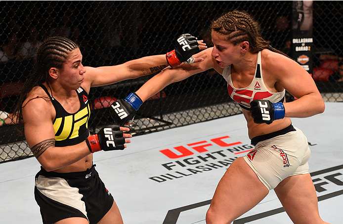 <a href='../fighter/Sarah-Moras'>Sarah Moras</a> punches <a href='../fighter/Jessica-Andrade'>Jessica Andrade</a> during their bout in 2015