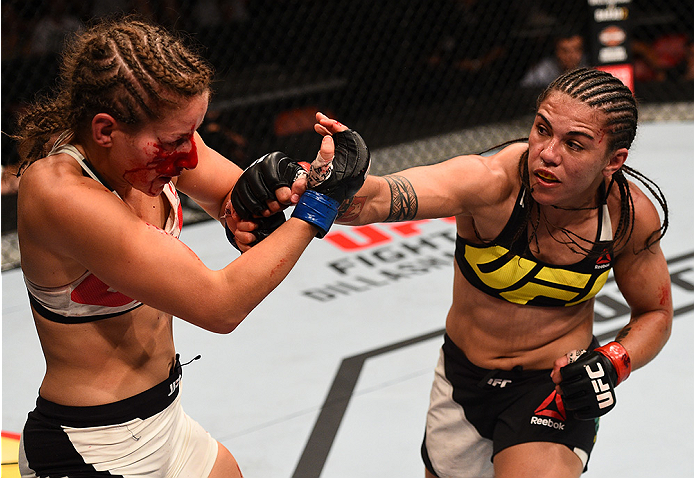 SAN DIEGO, CA - JULY 15:   (R-L) Jessica Andrade of Brazil punches Sarah Moras of Canada in their women's bantamweight bout during the UFC event at the Valley View Casino Center on July 15, 2015 in San Diego, California. (Photo by Jeff Bottari/Zuffa LLC/Zuffa LLC via Getty Images)