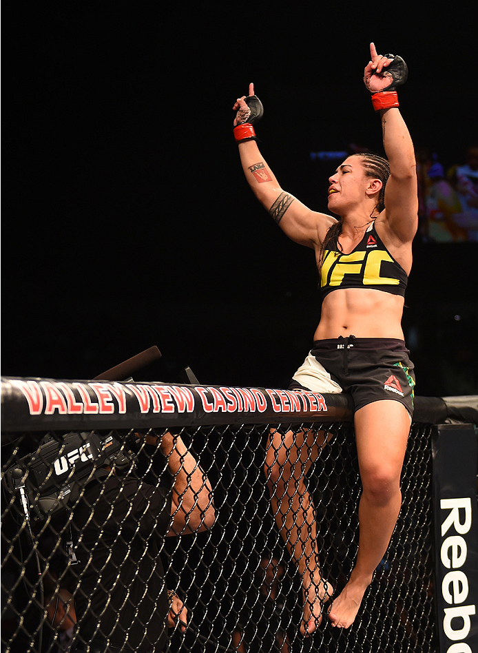 SAN DIEGO, CA - JULY 15:   Jessica Andrade of Brazil celebrates her victory over Sarah Moras of Canada in their women's bantamweight bout during the UFC event at the Valley View Casino Center on July 15, 2015 in San Diego, California. (Photo by Jeff Bottari/Zuffa LLC/Zuffa LLC via Getty Images)