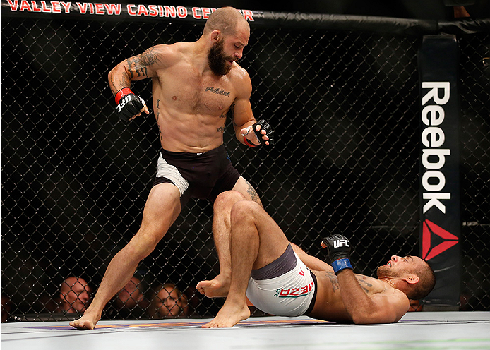 SAN DIEGO, CA - JULY 15:   Sam Sicilia (top) punches Yaotzin Meza in their featherweight bout during the UFC event at the Valley View Casino Center on July 15, 2015 in San Diego, California.  (Photo by Todd Warshaw/Zuffa LLC/Zuffa LLC via Getty Images)