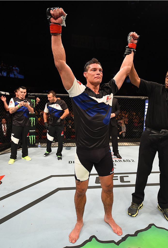 SAN DIEGO, CA - JULY 15:   Alan Jouban celebrates his victory over Matt Dwyer of Canada in their welterweight bout during the UFC event at the Valley View Casino Center on July 15, 2015 in San Diego, California. (Photo by Jeff Bottari/Zuffa LLC/Zuffa LLC via Getty Images)