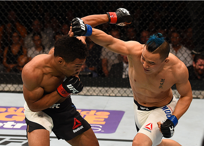 SAN DIEGO, CA - JULY 15:   (R-L) James Moontasri punches Kevin Lee in their lightweight bout during the UFC event at the Valley View Casino Center on July 15, 2015 in San Diego, California. (Photo by Jeff Bottari/Zuffa LLC/Zuffa LLC via Getty Images)