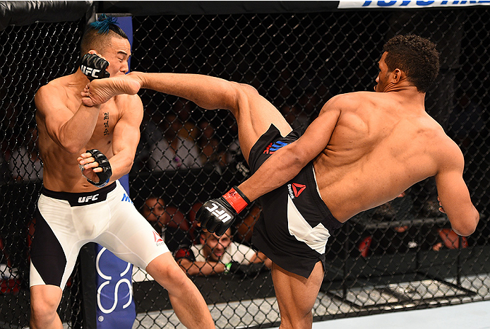 SAN DIEGO, CA - JULY 15:   (R-L) Kevin Lee kicks James Moontasri in their lightweight bout during the UFC event at the Valley View Casino Center on July 15, 2015 in San Diego, California. (Photo by Jeff Bottari/Zuffa LLC/Zuffa LLC via Getty Images)