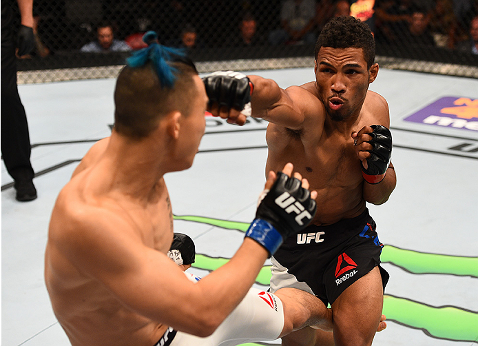 SAN DIEGO, CA - JULY 15:   (R-L) Kevin Lee punches James Moontasri in their lightweight bout during the UFC event at the Valley View Casino Center on July 15, 2015 in San Diego, California. (Photo by Jeff Bottari/Zuffa LLC/Zuffa LLC via Getty Images)