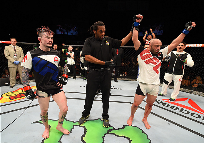 SAN DIEGO, CA - JULY 15:   (R-L) Manny Gamburyan celebrates his victory over Scott Jorgensen in their flyweight bout during the UFC event at the Valley View Casino Center on July 15, 2015 in San Diego, California. (Photo by Jeff Bottari/Zuffa LLC/Zuffa LLC via Getty Images)