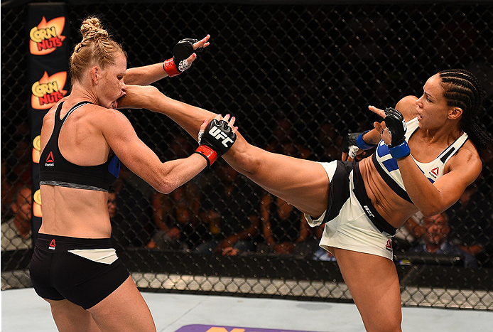 SAN DIEGO, CA - JULY 15:   (R-L) Marion Reneau kicks Holly Holm in their women's bantamweight bout during the UFC event at the Valley View Casino Center on July 15, 2015 in San Diego, California. (Photo by Jeff Bottari/Zuffa LLC/Zuffa LLC via Getty Images)
