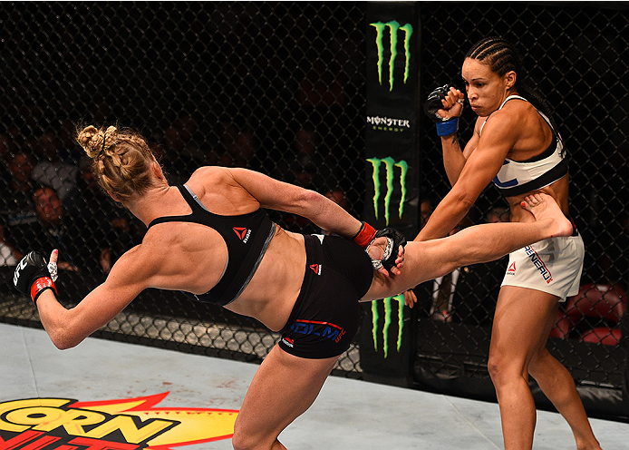 SAN DIEGO, CA - JULY 15:   (L-R) Holly Holm kicks Marion Reneau in their women's bantamweight bout during the UFC event at the Valley View Casino Center on July 15, 2015 in San Diego, California. (Photo by Jeff Bottari/Zuffa LLC/Zuffa LLC via Getty Images)