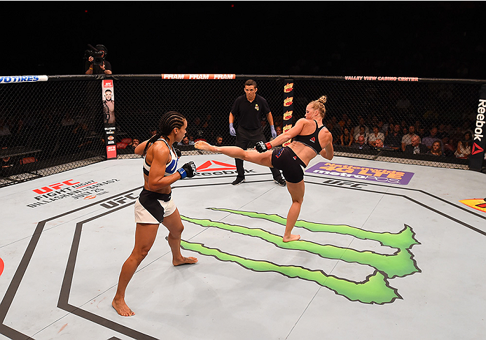 SAN DIEGO, CA - JULY 15:   (R-L) Holly Holm kicks Marion Reneau in their women's bantamweight bout during the UFC event at the Valley View Casino Center on July 15, 2015 in San Diego, California. (Photo by Jeff Bottari/Zuffa LLC/Zuffa LLC via Getty Images)
