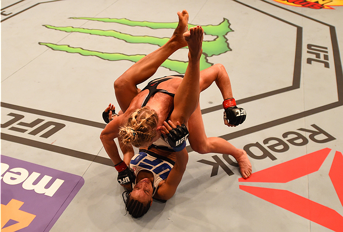 SAN DIEGO, CA - JULY 15:   Holly Holm (top) punches Marion Reneau in their women's bantamweight bout during the UFC event at the Valley View Casino Center on July 15, 2015 in San Diego, California. (Photo by Jeff Bottari/Zuffa LLC/Zuffa LLC via Getty Images)