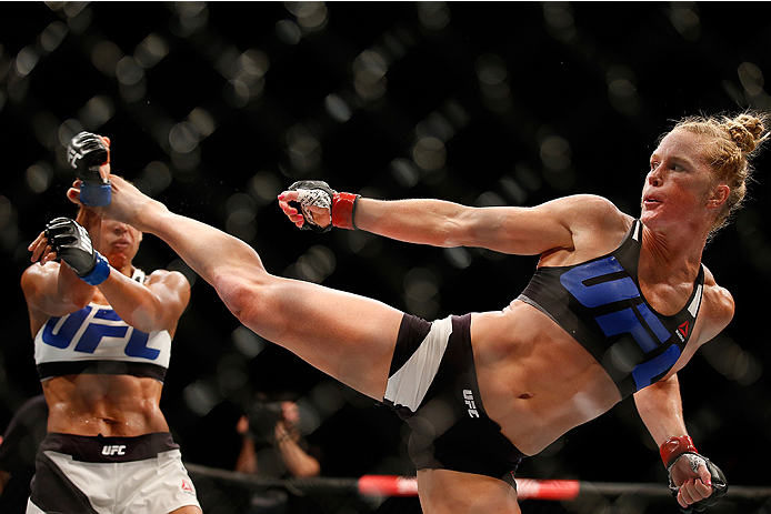 SAN DIEGO, CA - JULY 15:   (R-L) Holly Holm kicks Marion Reneau in their women's bantamweight bout during the UFC event at the Valley View Casino Center on July 15, 2015 in San Diego, California. (Photo by Todd Warshaw/Zuffa LLC/Zuffa LLC via Getty Images)