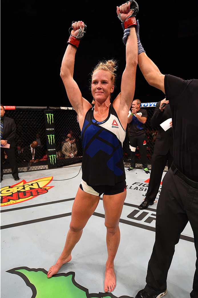 Holly Holm celebrates her victory over Marion Reneau in their women's bantamweight bout during the UFC event at the Valley View Casino Center on July 15, 2015 in San Diego, CA. (Photo by Jeff Bottari/Zuffa LLC)
