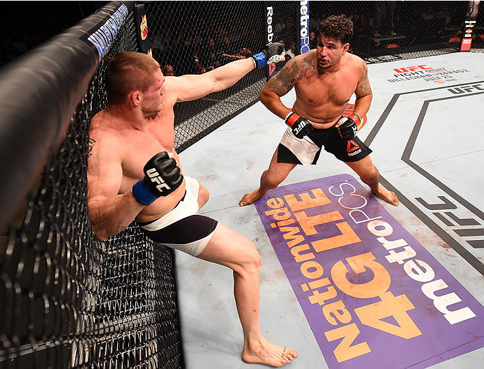 SAN DIEGO, CA - JULY 15:   (L-R) Todd Duffee punches Frank Mir in their heavyweight bout during the UFC event at the Valley View Casino Center on July 15, 2015 in San Diego, California. (Photo by Jeff Bottari/Zuffa LLC/Zuffa LLC via Getty Images)