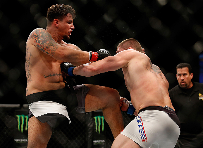 SAN DIEGO, CA - JULY 15:   (R-L) Frank Mir kneesTodd Duffee in their heavyweight bout during the UFC event at the Valley View Casino Center on July 15, 2015 in San Diego, California. (Photo by Todd Warshaw/Zuffa LLC/Zuffa LLC via Getty Images)