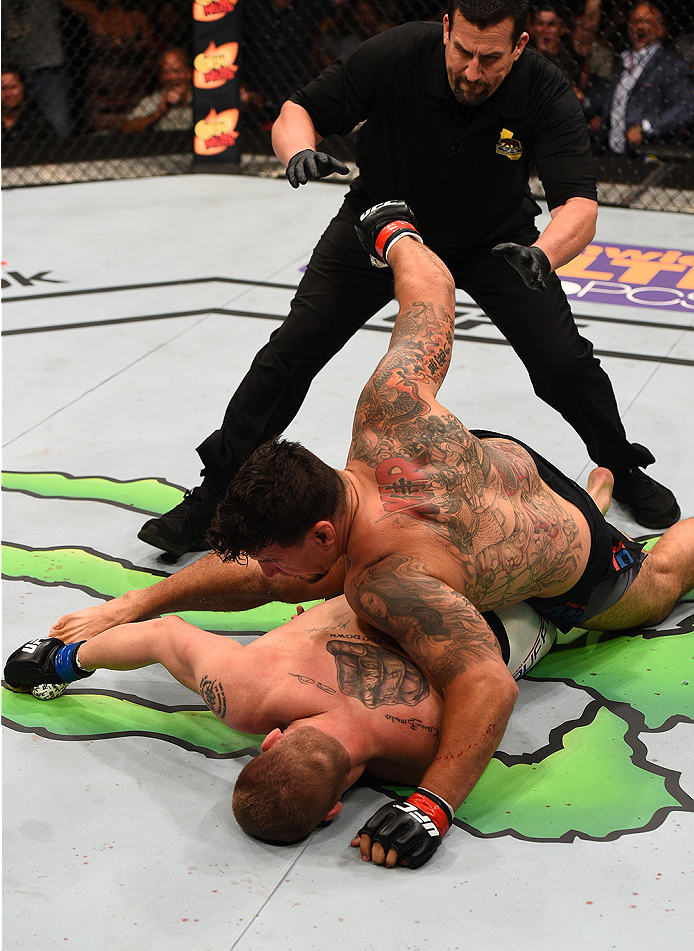 SAN DIEGO, CA - JULY 15:   Frank Mir (top) punches and knocks out Todd Duffee in their heavyweight bout during the UFC event at the Valley View Casino Center on July 15, 2015 in San Diego, California. (Photo by Jeff Bottari/Zuffa LLC/Zuffa LLC via Getty Images)