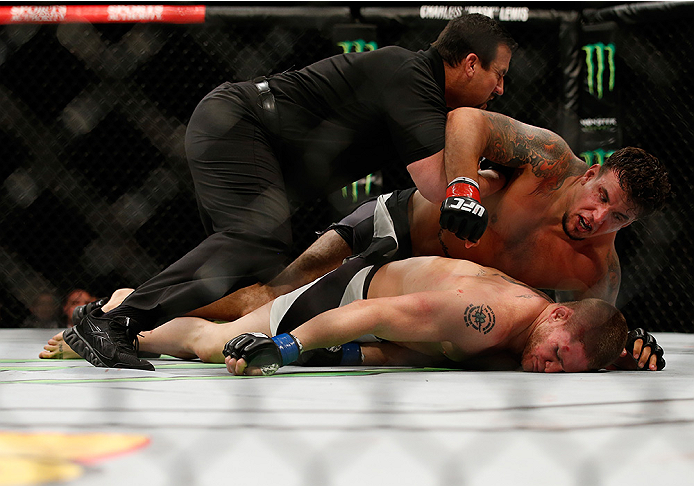 SAN DIEGO, CA - JULY 15:   (L-R) Frank Mir punches and knocks out Todd Duffee in their heavyweight bout during the UFC event at the Valley View Casino Center on July 15, 2015 in San Diego, California. (Photo by Todd Warshaw/Zuffa LLC/Zuffa LLC via Getty Images)