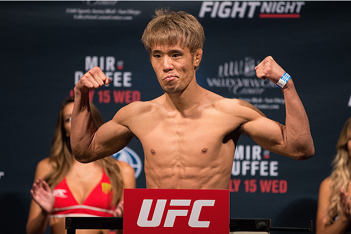 SAN DIEGO, CA - JULY 14:  Masanori Kanehara of Japan steps on the scale during the UFC weigh-in at the Valley View Casino Center on July 14, 2015 in San Diego, California. (Photo by Jeff Bottari/Zuffa LLC/Zuffa LLC via Getty Images)