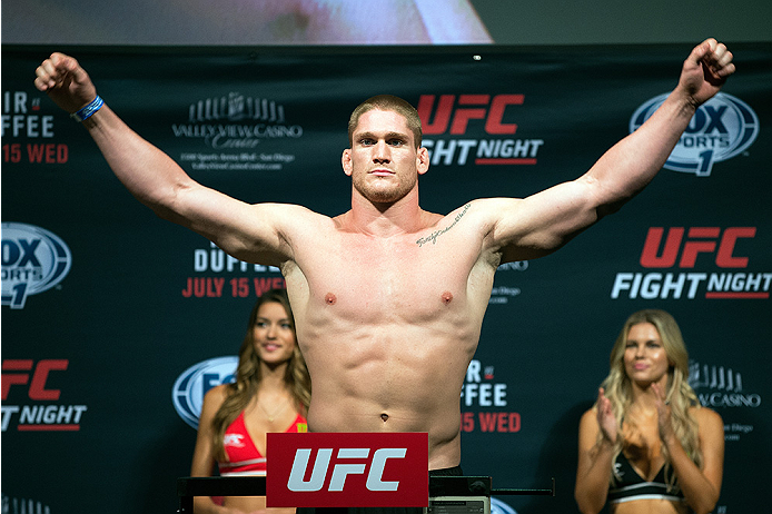 SAN DIEGO, CA - JULY 14:  Todd Duffee steps on the scale during the UFC weigh-in at the Valley View Casino Center on July 14, 2015 in San Diego, California. (Photo by Jeff Bottari/Zuffa LLC/Zuffa LLC via Getty Images)
