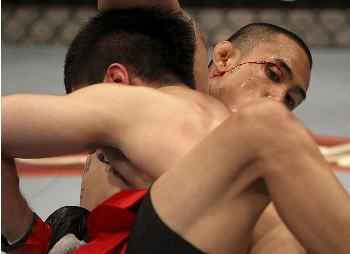 SINGAPORE - JANUARY 04:  David Galera suffers a little blood from his eye against Royston Wee in their bantamweight bout during the UFC Fight Night event at the Marina Bay Sands Resort on January 4, 2014 in Singapore. (Photo by Mitch Viquez/Zuffa LLC/Zuffa LLC via Getty Images)