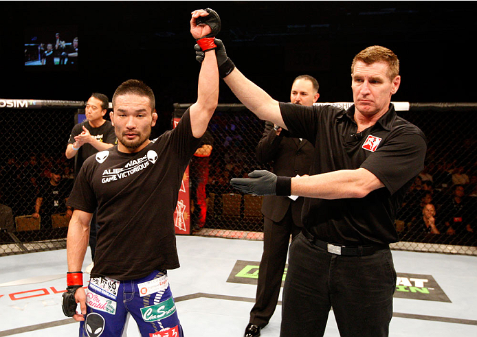SINGAPORE - JANUARY 04: Katsunori Kikuno wins his  lightweight bout against Quinn Mulhern during the UFC Fight Night event at the Marina Bay Sands Resort on January 4, 2014 in Singapore. (Photo by Mitch Viquez/Zuffa LLC/Zuffa LLC via Getty Images)