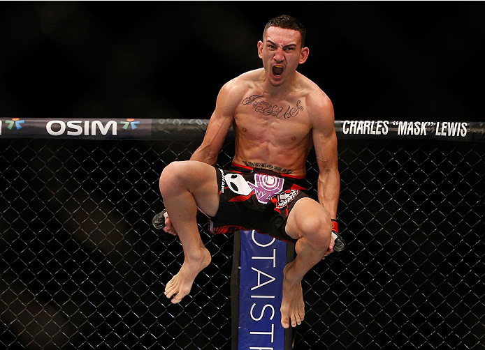 SINGAPORE - JANUARY 04:  Max Holloway reacts after his TKO victory over Will Chope in their featherweight bout during the UFC Fight Night event at the Marina Bay Sands Resort on January 4, 2014 in Singapore. (Photo by Josh Hedges/Zuffa LLC/Zuffa LLC via Getty Images)