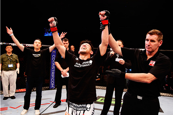 SINGAPORE - JANUARY 04:  Tatsuya Kawajiri celebrates his win over Sean Soriano in their featherweight bout during the UFC Fight Night event at the Marina Bay Sands Resort on January 4, 2014 in Singapore. (Photo by Mitch Viquez/Zuffa LLC/Zuffa LLC via Getty Images)