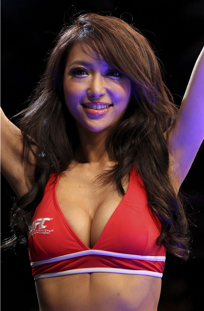 SINGAPORE - JANUARY 04: UFC ring girl,Azusa Nishigaki, walks around in between rounds during the UFC Fight Night event at the Marina Bay Sands Resort on January 4, 2014 in Singapore. (Photo by Mitch Viquez/Zuffa LLC/Zuffa LLC via Getty Images)