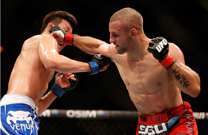 SINGAPORE - JANUARY 04:  (R-L) Tarec Saffiedine punches Lim Hyun Gyu in their welterweight bout during the UFC Fight Night event at the Marina Bay Sands Resort on January 4, 2014 in Singapore. (Photo by Josh Hedges/Zuffa LLC/Zuffa LLC via Getty Images)