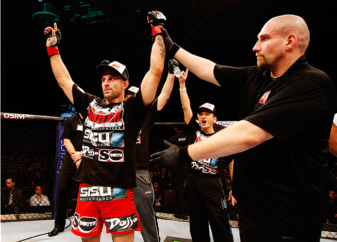 SINGAPORE - JANUARY 04:  Tarec Saffiedine celebrates after his win over Lim Hyun Gyu in their welterweight bout during the UFC Fight Night event at the Marina Bay Sands Resort on January 4, 2014 in Singapore. (Photo by Mitch Viquez/Zuffa LLC/Zuffa LLC via Getty Images)