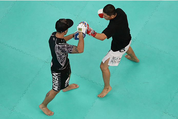 SINGAPORE - JANUARY 01:  Jon Delos Reyes of Guam in action during the UFC Fight Night Singapore Open Workouts at the Skating Rink at The Shoppes at Marina Bay Sand on January 1, 2014 in Singapore.  (Photo by Suhaimi Abdullah/Zuffa LLC via Getty Images)