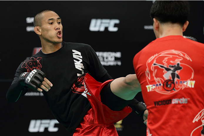 SINGAPORE - JANUARY 01:  Dave Galera of Philippines in action during the UFC Fight Night Singapore Open Workouts at the Skating Rink at The Shoppes at Marina Bay Sand on January 1, 2014 in Singapore.  (Photo by Suhaimi Abdullah/Zuffa LLC via Getty Images)