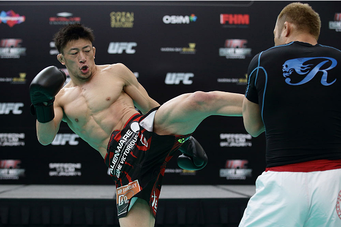 SINGAPORE - JANUARY 01:  Tatsuya Kawajiri of Japan in action during the UFC Fight Night Singapore Open Workouts at the Skating Rink at The Shoppes at Marina Bay Sand on January 1, 2014 in Singapore.  (Photo by Suhaimi Abdullah/Zuffa LLC via Getty Images)
