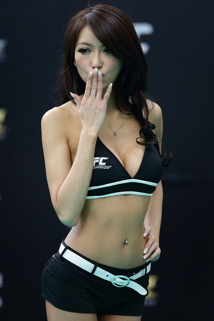 SINGAPORE - JANUARY 01:  Octagon ring girl and former Miss Japan Universe finalist, Azusa Nishigaki makes an appearance during the UFC Fight Night Singapore Open Workouts at the Skating Rink at The Shoppes at Marina Bay Sand on January 1, 2014 in Singapore.  (Photo by Suhaimi Abdullah/Zuffa LLC via Getty Images)